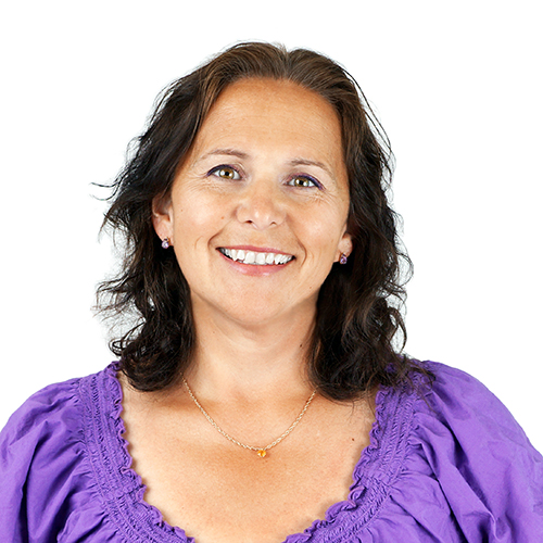 Sign language services client smiling wearing a blue shirt